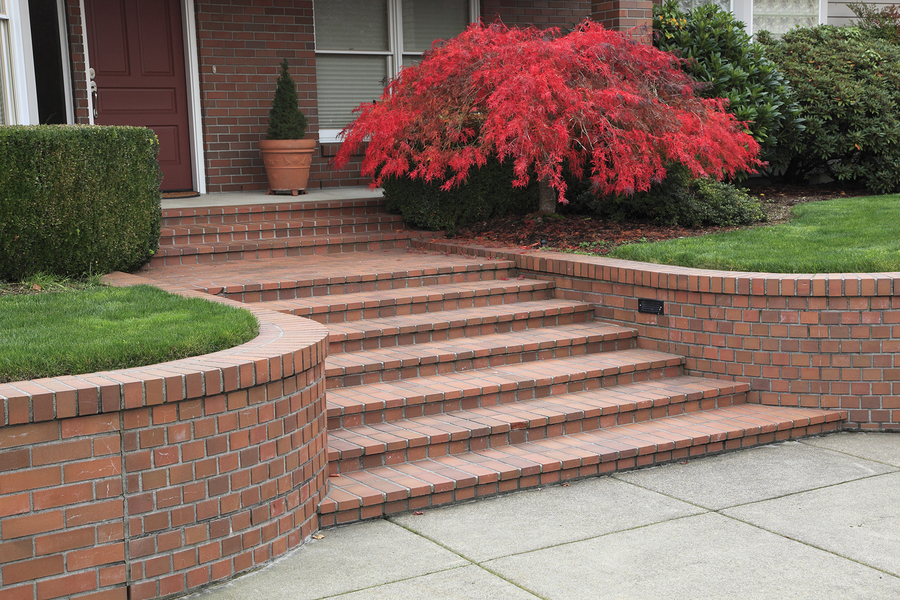 red brick steps leading to a home's front door.